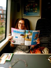Reading Womans Own on the Stansted express